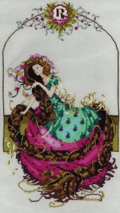 """Rapunzel is the title of this cross stitch pattern from Mirabilia that is stitched with DMC threads and Kreinik (Vintage Burgandy, Topaz, Mallard). Click on highlighted links to add the embellishment pack and Kreinik fibers to your shopping cart. Second photo with permission of the designer. Finished size is approximately 10.125"""" x 18.6"""" when stitched on 32 ct"""