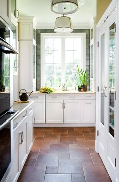 I like the patterned kitchen tile floor.  Design Tips by Skip Sroka... Love the pattern. I want it when we do our floors in the coming weeks/months.