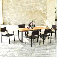 """The unique base design ensures the good weight capacity. In order to increase stability, the table also has adjustable non-slip feet for use on uneven ground. This dining set also includes 6 comfortable chairs made of rattan, which is enough for you and your family. Moreover, the lightweight chair allows you to use it elsewhere effortlessly. The classic tabletop has an umbrella hole with a diameter of 2.16"""" to facilitate the installation of umbrella."""