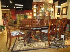 "Traditional style Councill double pedestal base table in a medium finish with brass feet & 6 chairs. The chairs have a whimsical checkered seat. 72""L X 46""W; (3)20""lfs. Wow! At posting, we have the matching buffet."