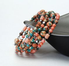 Coral Rainflower Stone Memory Wire Bracelet by lilicharms on Etsy