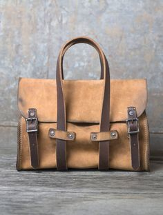 The Cecilia Bag is handcrafted out of luxurious calfskin and bears a hand-distressed finish for a timeworn look. It's aesthetic is sophisticated and rustic, making for a distinct piece to accommodate your daily goods. Bags are made to order, so please allow 1-2 weeks for delivery. #TaiganHoliday