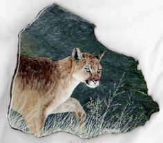 Mountain lion oil painting on California jade rock slab. by Barbara and Chuck Gularte in Old Station, California