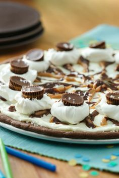 Dessert pizza with soft sugar cookie base and topped with whipped topping and candies!
