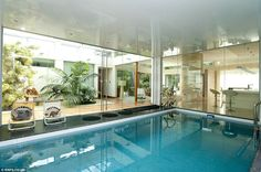 Indoor pool: The swimming pool in the bright and airy glass-panelled three-bedroom home