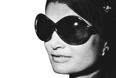 Jacqueline Kennedy.  Oh how we love the sunglasses.