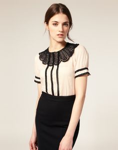 The scalloped, delicate detail on the neckline really makes this blouse.