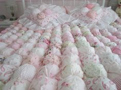 My queen size puff quilt made with over 300 squares in pinks and whites