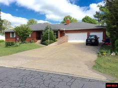 Spacious one owner brick home with large formal dining room. Includes refrigerator, range, microwave, dishwasher, garbage disposal, water softener, garage door opener/remote. Appliances in working order but not warranted. All season room is heated only. Home has whole house fan located in utility room. Home is partially handicap accessible in Mountain Home AR