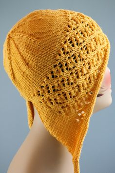 Free knitting pattern for Floral Mesh Bonnet - Gretchen Tracy designed this lace cloche that extends over the ears in sizes from child through adult.
