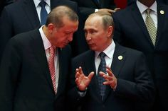 Russian President Vladimir Putin talks with Turkey's President Recep Tayyip Erdogan during a G-20 summit...