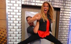 """""""Big Brother"""" 17 houseguest Clay lifts Shelli in the air."""