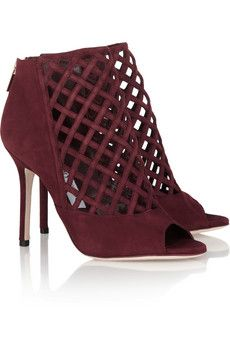 These tell a story of their own...We really like the details...color and woven cage @Jimmy Choo $995