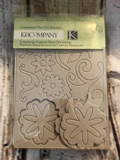 K & Company Die-Cut Chipboard Florals And Swooshes. New. Embellishments for scrapbooking, greeting cards, boxes and much more.