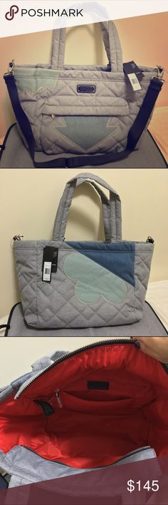 "MARC BY MARC JACOBS CrosbyQuilt Elizababy Baby Bag Authentic MBMJ Elizababy Baby Bag/diaper bag. New with tags. Never worn or used. Color: Pacific Ocean Chambray Multi. topstitched appliqué brings a playful look to this quilted chambray baby bag. enameled logo. Padded straps. Fabric: Quilted denim / chambray. Double handles, detachable adjustable crossbody strap. Zip closure; lined. Exterior front zip pocket. interior zip pocket, interior slip pocket. Removable changing pad.  19""L x 7""W x…"