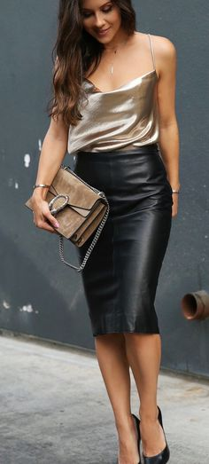 11e0a7cd30 #spring #outfits woman wearing black leather skirt holding brown shoulder  bag. Pic by