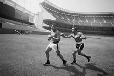 Ali was 34 by the time this photograph was taken of him and Ken Norton playfully chasing one another across the field at Yankee Stadium. You don't get fight promotions like this these days. Also, as my colleague pointed out, look at their shoes – what on earth are they wearing those Cuban heels for?!