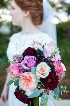 Stunning wedding bouquet filled with pink and purple hues!