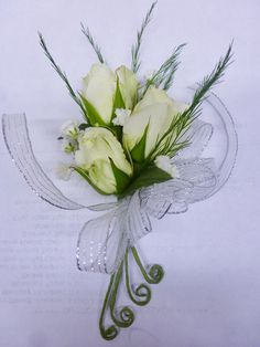 Classy and elegant in white and silver! A perfect corsage!