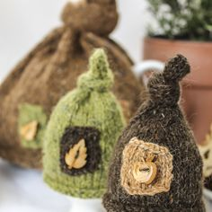 Very charming egg cosies and tea cosy  made from Rowan felted tweed DK, decorated with wooden buttons, will brighten up any breakfast.