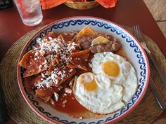 Chilaquiles. Best breakfast ever... especially on this pretty glazed plate in Barra de Navidad, Mexico.