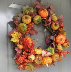 DIY fall wreaths: This wreath is made with faux produce, dried leaves and mini gourds.