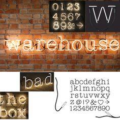 Lettres néon sur brique