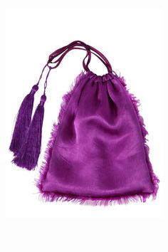 A silk pouch worn as an evening purse is a rarity, but this one is legitimately sexy. Bonus: there's a matching dress to go with it.