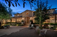 This newly constructed stunning French provincial home in the upscale neighborhood of Paradise Valley, Arizona was designed by Higgins Architects.