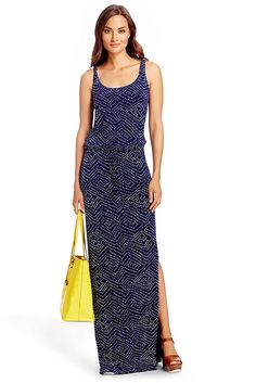 The DVF Sophie is the relaxed maxi dress of the season. This super soft dress features a drawstring waist, side slit and a chic navy batik print. Features tank front, high back. Floor length. Fit is true to size.