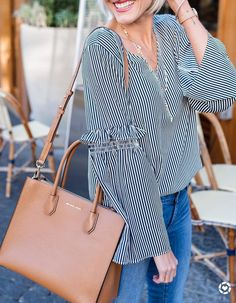 #winter #outfits striped black and white top, jeans, brown bag