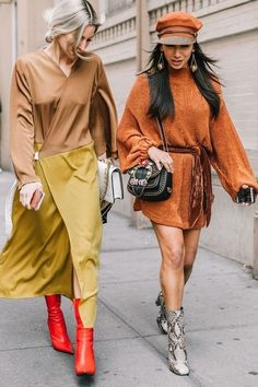 Loving these outfit colors! A nude flowy top with a yellow skirt, and red boots? Love! The matching orange fisherman hat and sweater dress? Chic!