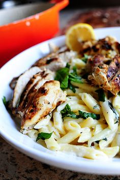 Grilled Chicken with Lemon Basil Pasta  4 whole Grilled Chicken Breasts, Sliced  1 pound Penne Pasta, Cooked Until Al Dente  1/2 stick Butter  3 whole Lemons, Juiced  3/4 cups Heavy Cream  1/4 cup Half-and-half  1-1/2 cup Grated Parmesan Cheese (or Romano)  Salt And Freshly Ground Black Pepper, To Taste  20 whole Basil Leaves, Chopped