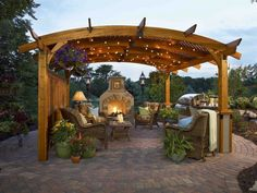 exterior-valuable-with-wood-pergola-design-and-wooden-ceiling-with-light-little-lights-also-charming-stone-floor-and-rattan-seating-also-featured-fireplace- ...