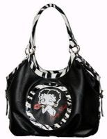 "This Betty Boop Zebra print hobo bag has the following features Licensed Betty Boop bag with top zipper closure bag Rhinestones and zebra trim with contrasting color on front Double handles Famous Betty featured on this classic handbag Fully lined interior Approximate Size: 17""L x 11""H x 5""W"