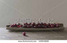 Cherries on plateau on gray background Image ID:439949608 Copyright: Alina Craita