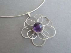 Silver and Amethyst Pendant  Sterling Silver.  So unique and lovely!