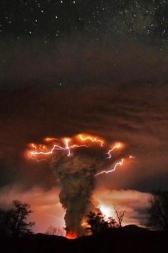 Lightning Blasting Down upon fumes of Volcanic Ash - have a look at the stars above... wow love this