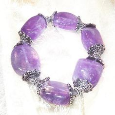 Amethyst Nugget Bracelet In Sterling Silver, Handmade Jewelry By NorthCoastCottage Jewelry Design & Vintage Treasures. Encircle your wrist with the beauty and power of large natural free-form amethyst nuggets tumbled to a fine and comforting smoothness and embellished with ornate