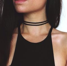 This double stranded faux leather choker is the perfect mix of edgy and bohemian. It is 11 in length and is finished with gold tone findings and a 3