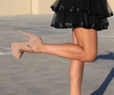 Love the nude pumps.& Black Skirt!