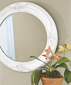 Position a mirror to catch the light and bring the sun into a darker hallway. Paint the mirror a clean, crisp white for added brightness.