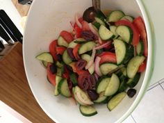 Awesome cold salad: hothouse cucumber, tomato, thinly sliced red onion, kalamata olives and a dressing of white wine vinegar, olive oil, salt and pepper. Next time adding some feta!
