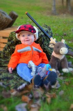Baby camo and hunting picture