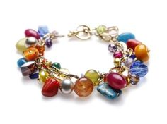 Love color? Handmade Gauguin - Goldfill Bracelet, with Carnelian, Coral, Serpentine and Freshwater Pearls. 7 & 3/4 inch length. $208