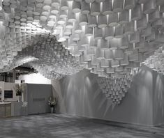 Simple cardboard tubes used to create an undulating exhibit. Paper Chandeliers by Cristina Parreño Architecture
