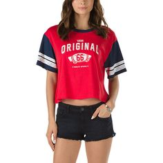 The OG High Cropped T-Shirt is a 100% cotton cropped sport crew tee with sleeve striping and front graphics. Model is 5 feet 9 inches tall and wearing a size Small.