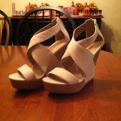JustFab Tan Wedges size 9 never worn! Tan wedges -- size 9 -- never worn -- zipper enclosure on back -- small makeup mark on strap of shoe, will try to get the mark out before sending but cannot make any promises! Please ask for more pictures if interested in the makeup mark JustFab Shoes Wedges
