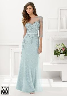 Evening Gowns and Mother of the Bride Dresses by VM Collection Beaded Net over Lace Available in Navy, Champagne, Pewter.