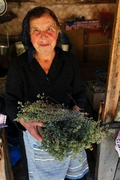 A woman with bunches of Greek oregano.